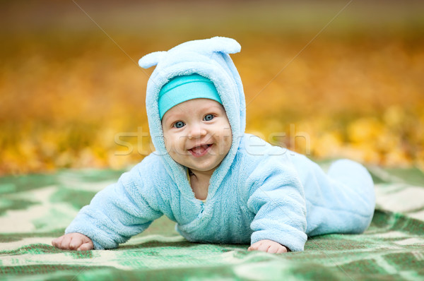 Happy baby boy in autumn park Stock photo © photobac