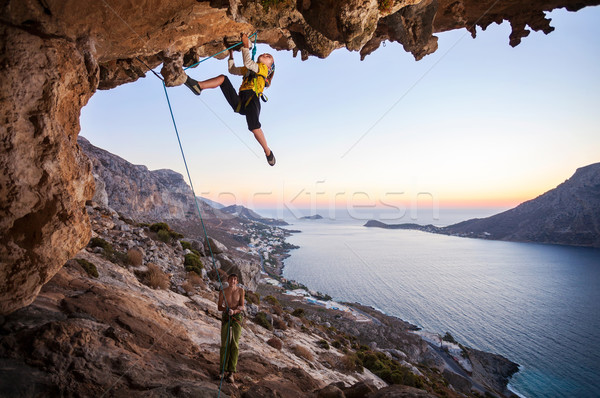 Stock photo: Seven-year old girl climbing a challenging route
