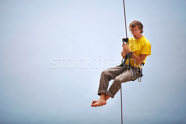 Climber belaying and being pulled up other climber Stock photo © photobac