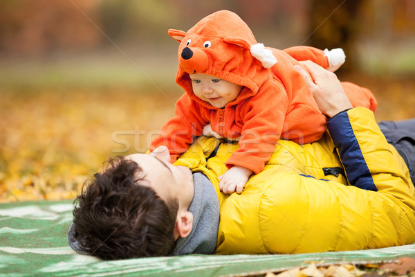 Stock photo: Father and his son in fox costume