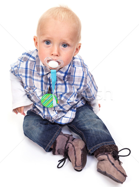 Cute blonde blue-eyed little boy with a pacifier Stock photo © photobac