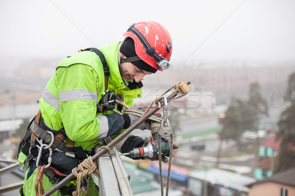 Industrial climber on a metal construction Stock photo © photobac