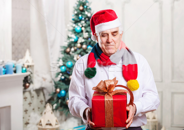 Senior man with gift box on Christmas background Stock photo © photobac