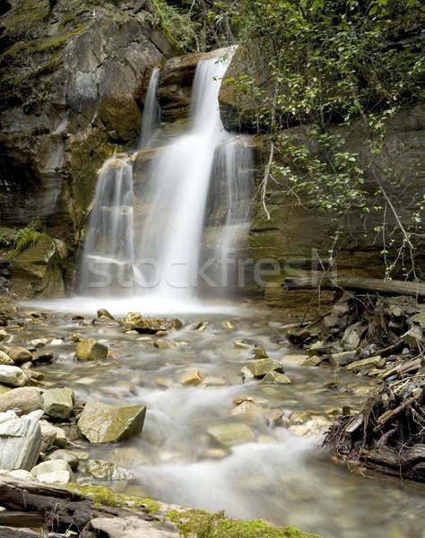Rainbow abbassare cascata Foto d'archivio © photoblueice