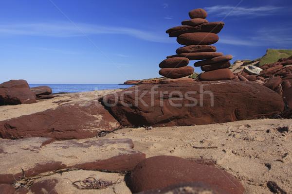 Inukshuk made of Red rocks Stock photo © photoblueice