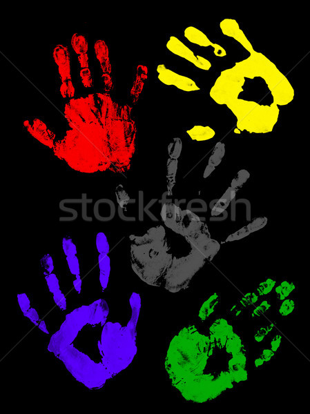 Stock photo: Colorful handprints on a black background