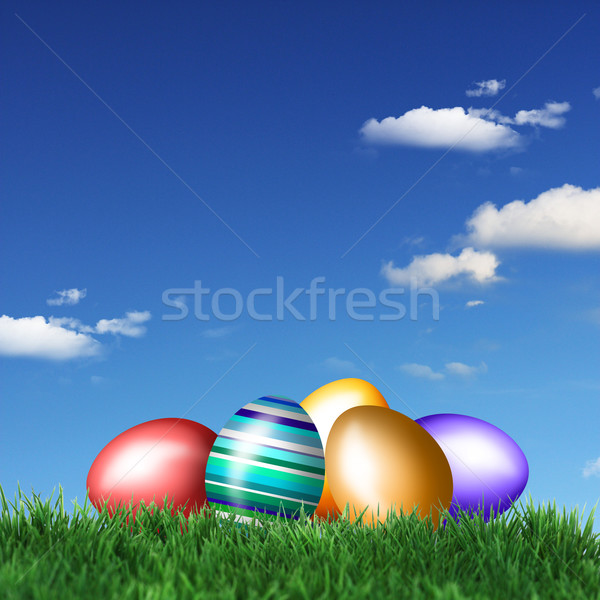 Stock photo: Colored Easter eggs in grass