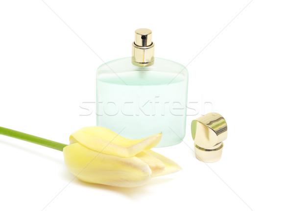 bottle of perfume and a yellow tulip Stock photo © Photocrea