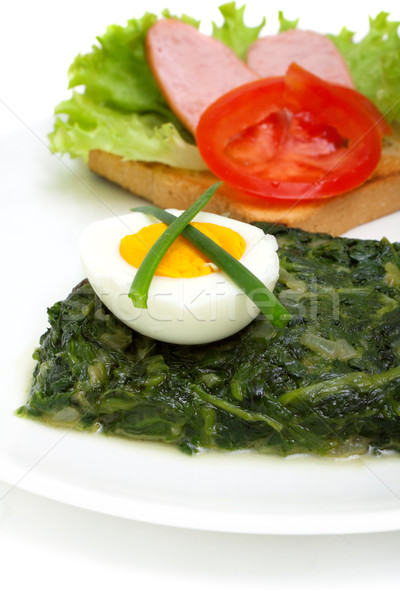 sauteed spinach, egg and sandwich for breakfast isolated on whi Stock photo © Photocrea