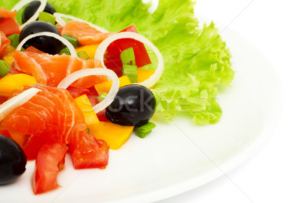 vegetable salad with salmon isolated on white, the focus at the  Stock photo © Photocrea