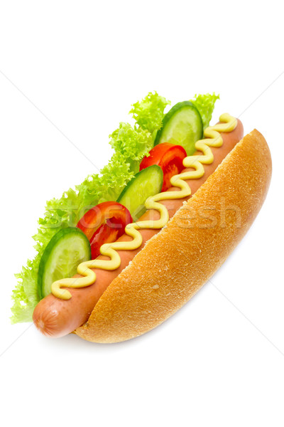 Hot dog with cucumbers, tomatoes, lettuce, and mustard on top isolated on white Stock photo © Photocrea
