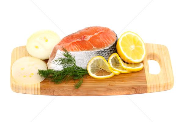 salmon steak, lemon and onions on a cutting board Stock photo © Photocrea