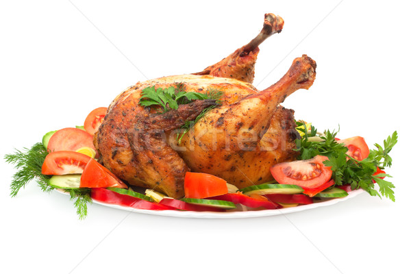 roast chicken with vegetables on a plate isolated on white Stock photo © Photocrea