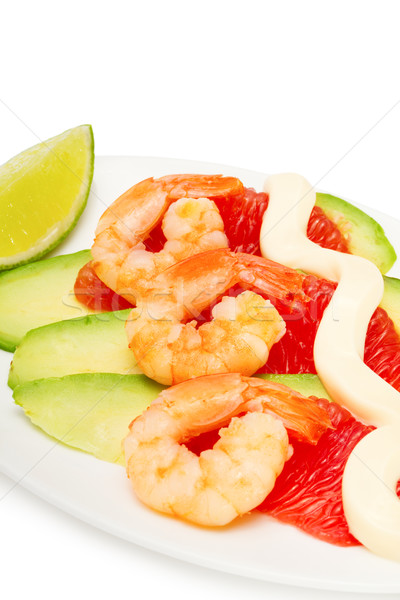 Salad with shrimp, avocado and grapefruit isolated on white, focus on foreground Stock photo © Photocrea