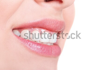 Smile of a beautiful young woman isolated on white Stock photo © Photocrea