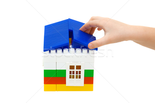 hand puts the roof on the house constructed from toy blocks  Stock photo © Photocrea