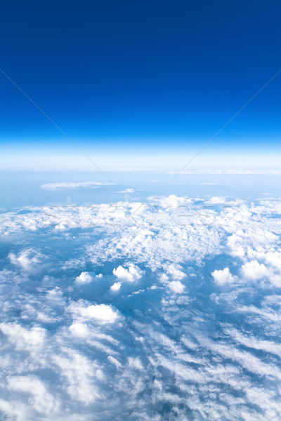 Blue sky high view from airplane clouds shapes Stock photo © Photocrea