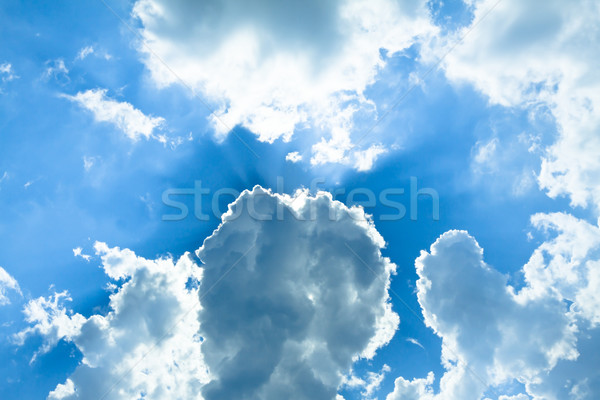 sun behind white fluffy clouds in the blue sky Stock photo © Photocrea