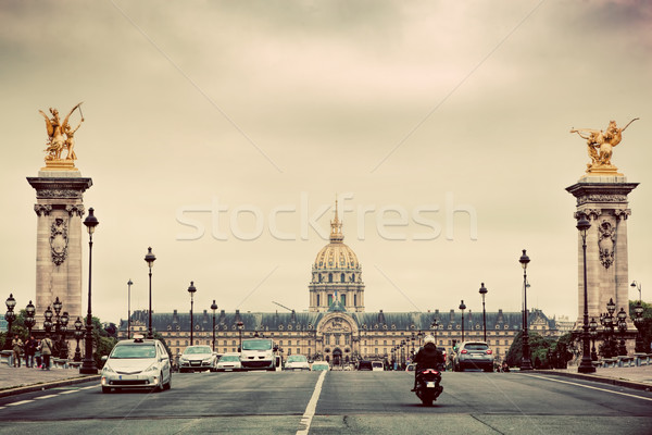 Les Invalides seen from Pont Alexandre III bridge in Paris, France. Vintage Stock photo © photocreo