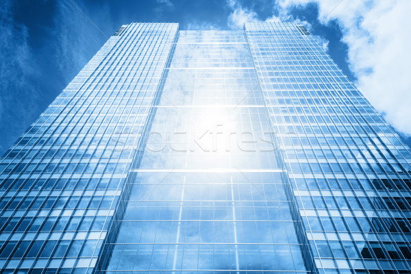 Sun reflecting in modern business skyscraper, high-rise building, Stock photo © photocreo
