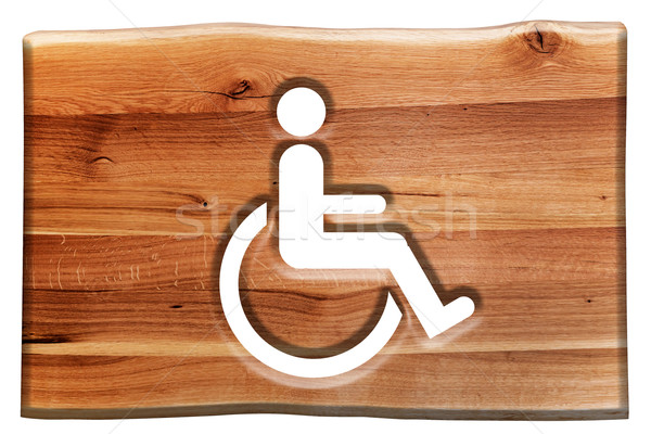 Man on wheelchair sign, symbol of handicapped, disabled person in wooden board. Stock photo © photocreo