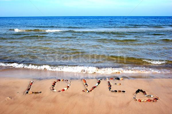 Word LOVE on beach sand Stock photo © photocreo