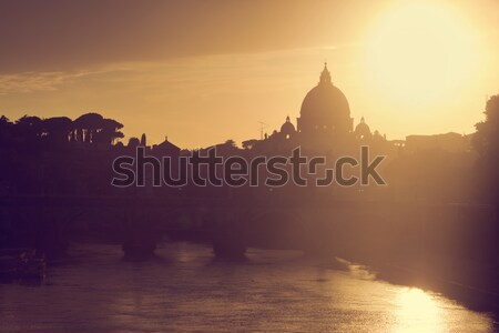 St. Peter's Basilica, Vatican City.  Tiber river in Rome, Italy at sunset Stock photo © photocreo