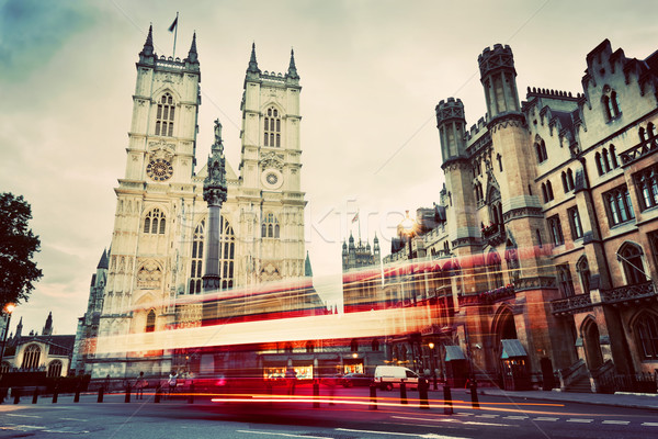 Westminster Abbey church, red bus moving in London UK. Vintage Stock photo © photocreo