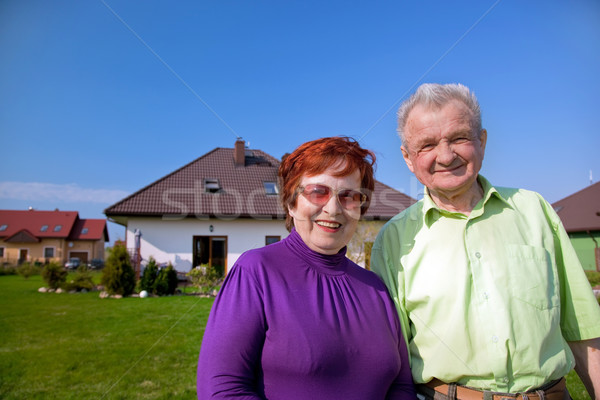 Senior couple in front of the house Stock photo © photocreo