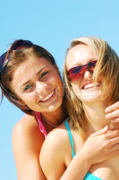 Young women on the summer beach Stock photo © photocreo