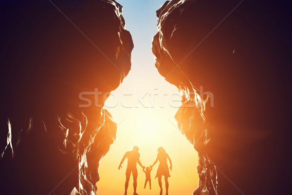 Happy family in between two mountains at the entrance of new better world. Stock photo © photocreo
