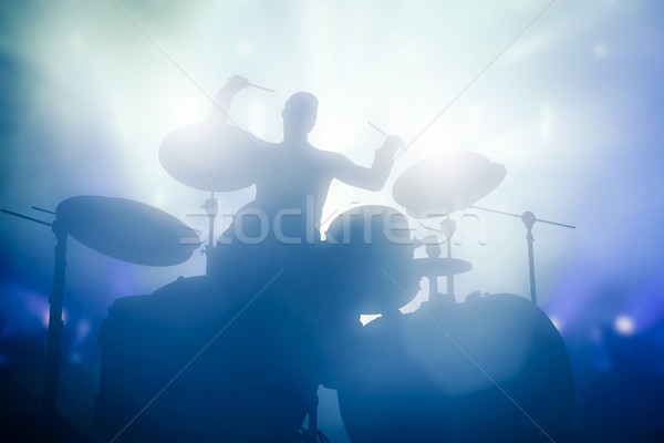 Drummer playing on drums on music concert. Club lights Stock photo © photocreo