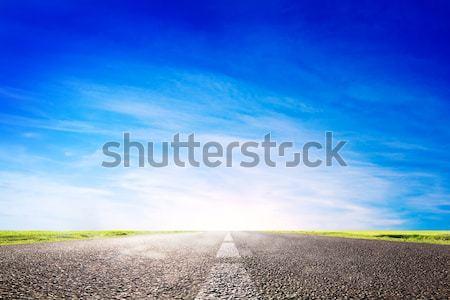 Long empty asphalt road, highway towards sun Stock photo © photocreo