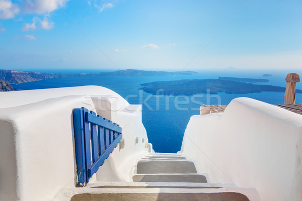 Santorini, Greece. Open blue door with Aegean sea view and Caldera. Stock photo © photocreo