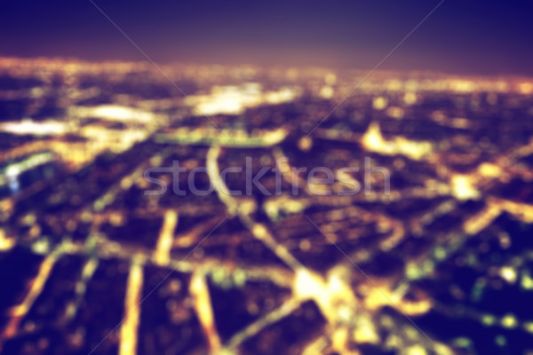 Big city night lights bokeh, blurred background. Vintage Stock photo © photocreo