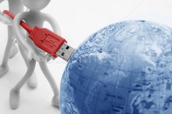 USB plugs into earth. Conceptual Stock photo © photocreo