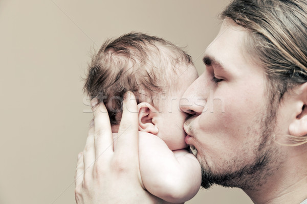 Father with his young baby cuddling and kissing him on cheek Stock photo © photocreo
