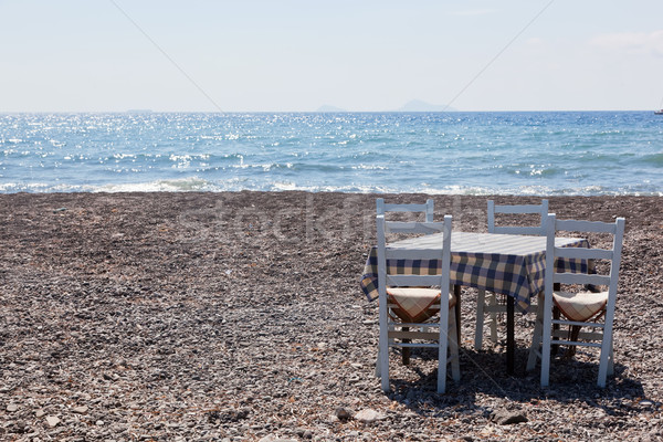 Table with chairs on the beach. Tavern in Greece, Santorini Stock photo © photocreo