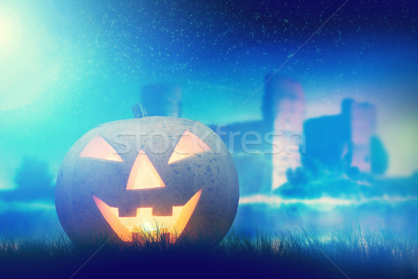 Halloween pumpkin glowing in dark, misty scenery with gothic castle and moon Stock photo © photocreo