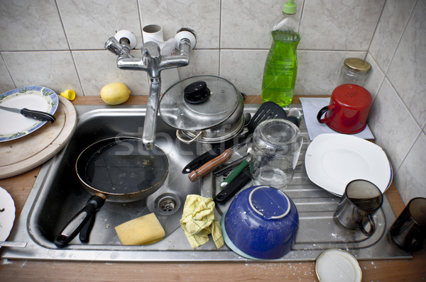 Pile of dirty dishes in the metal sink Stock photo © photocreo