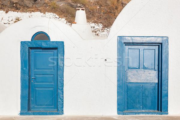Grunge öreg kék ajtók város Santorini Stock fotó © photocreo
