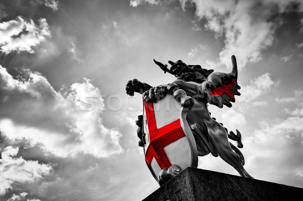 St George dragon statue in London, the UK. Black and white, red flag, shield. Stock photo © photocreo
