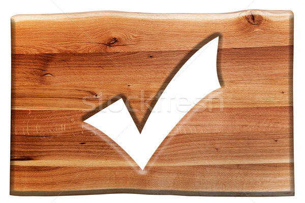 Tick, checking mark symbol cut in wooden board isolated on white Stock photo © photocreo