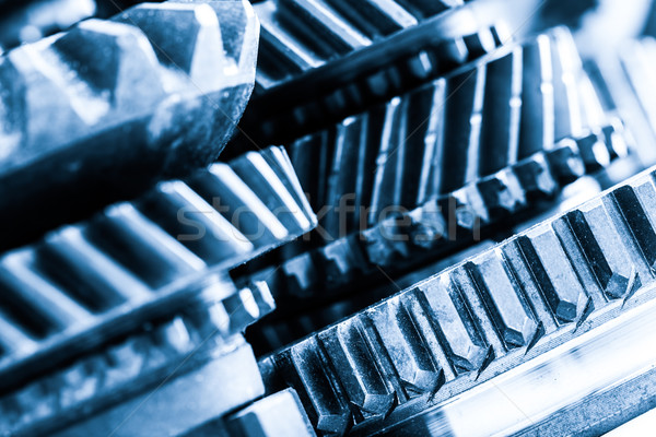 Gears, grunge cogwheels, real engine elements close-up. Heavy in Stock photo © photocreo
