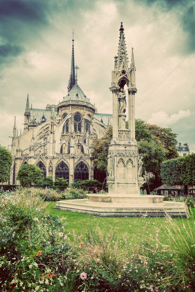 Notre Dame Cathedral in Paris, France. Square Jean XXIII. Vintage Stock photo © photocreo