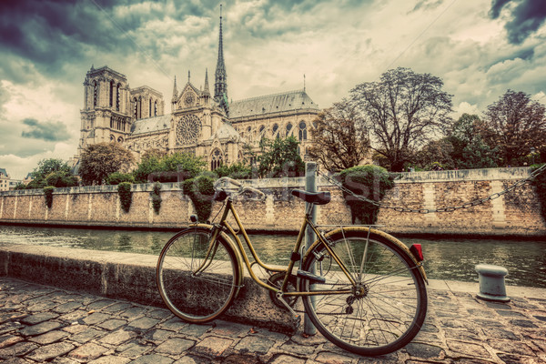 Retro bike next to Notre Dame Cathedral in Paris, France. Vintage Stock photo © photocreo