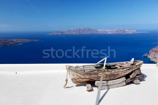 Old boat on the roof of the building on Santorini island, Greece Stock photo © photocreo