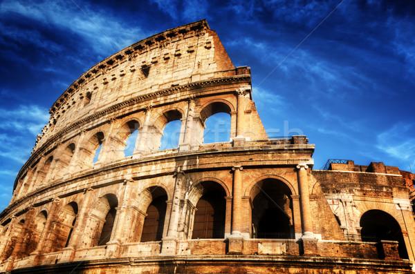 Colosseum Róma Olaszország mély kék ég szimbólum Stock fotó © photocreo