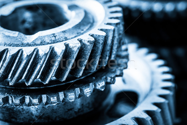 Gears, grunge cogwheels, real engine elements close-up. Heavy industry Stock photo © photocreo