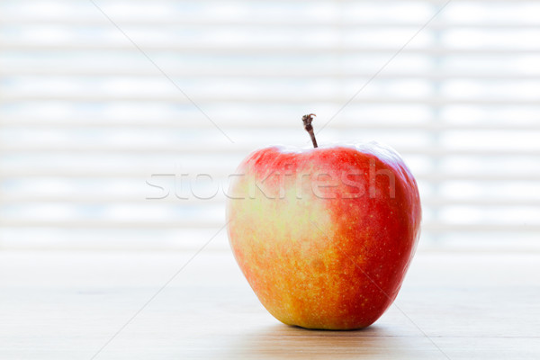Ripe apple on the table in morning light. Diet breakfast, healthy food Stock photo © photocreo